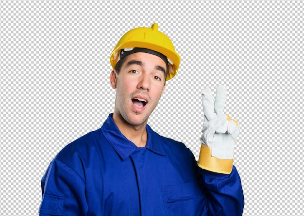 Happy worker with victory gesture on white background