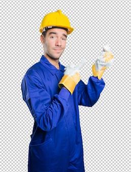 Happy workman with money gesture on white background