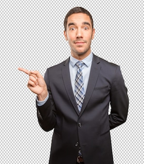 Happy young businessman pointing