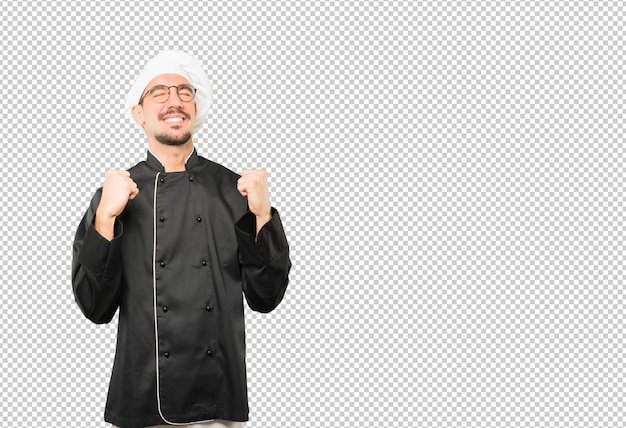 Happy young chef doing a competitive gesture