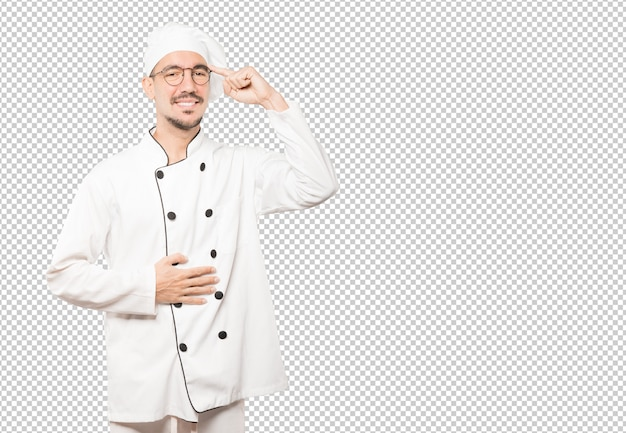 Happy young chef doing a gesture of concentration