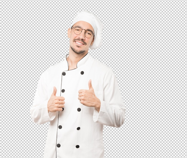 Happy young chef gesturing that everything is fine