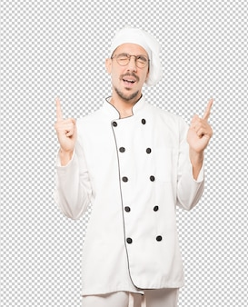 Happy young chef having fun