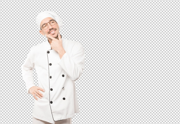 Happy young chef making a gesture of doubt
