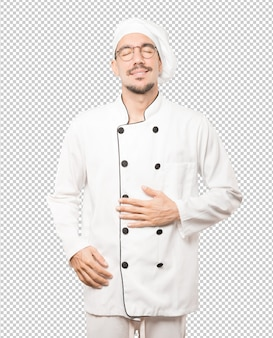 Happy young chef thinking of food