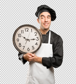 Happy young chef using a watch