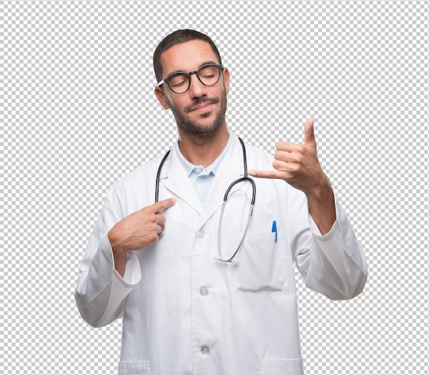 Happy young doctor doing a gesture of calling with the hand