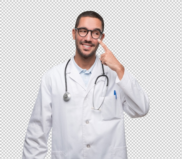 Happy young doctor doing a gesture of observe