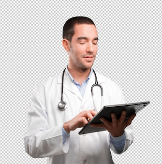 Happy young doctor using a tablet