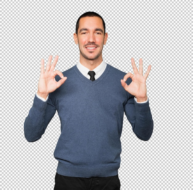 Happy young man doing an all right gesture