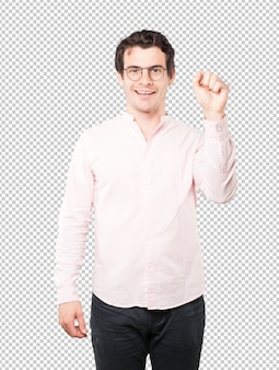 Happy young man doing a competitive gesture