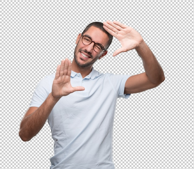 Happy young man doing a frame gesture with his hands