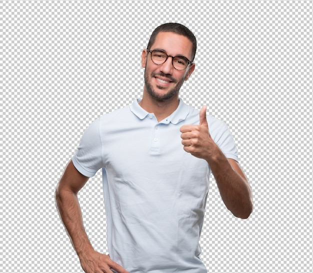 Happy young man doing a gesture of okay