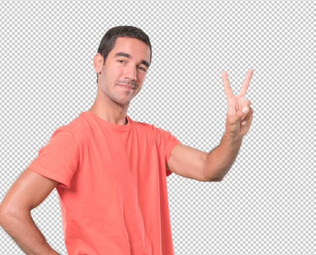 Happy young man doing a number two gesture