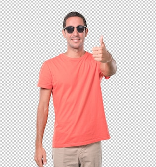 Happy young man doing an okay gesture