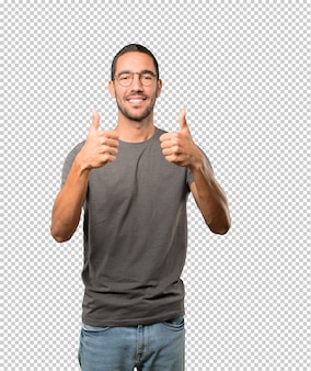 Happy young man gesturing that everything is fine