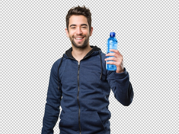Happy young man holding a bottle of water
