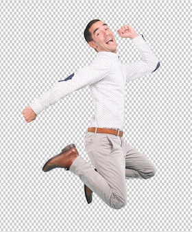 Happy young man jumping with a gesture of celebration - full body shot