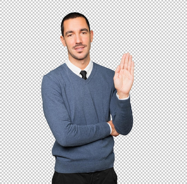 Happy young man making a gesture of stop with his palm