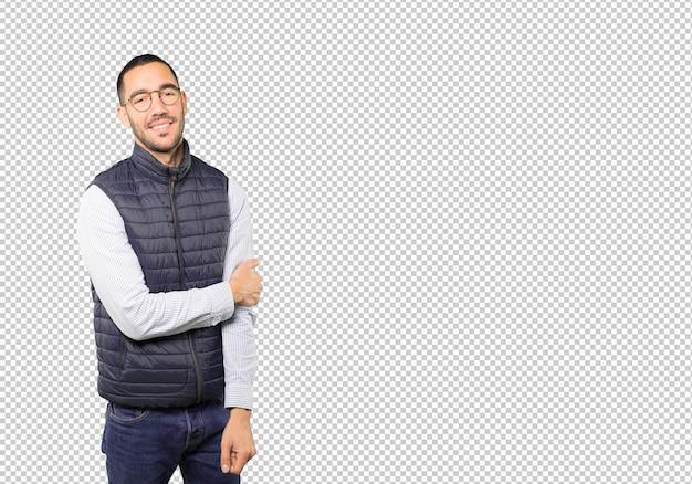Happy young man posing