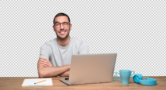 Happy young man sitting at his desk and winking an eye