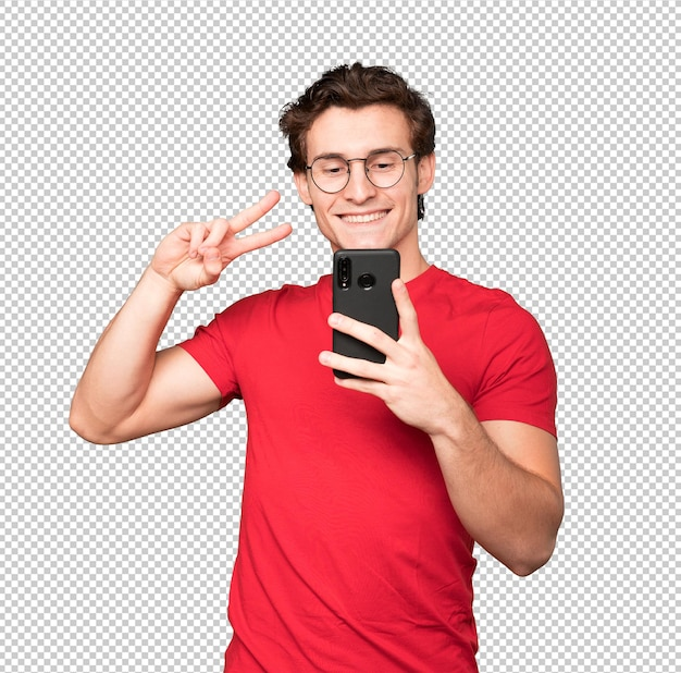 Happy young man taking a selfie with his mobile phone
