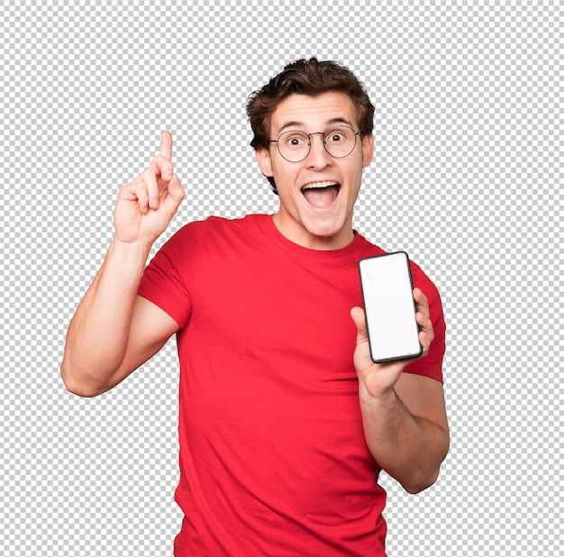 Happy young man using a mobile phone and pointing up