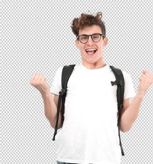 Счастливый молодой студент с жестом празднования