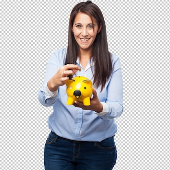 Happy young-woman with piggy-bank