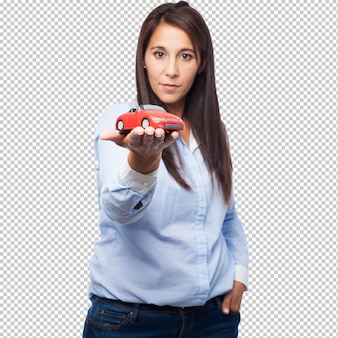 Happy young woman with red car