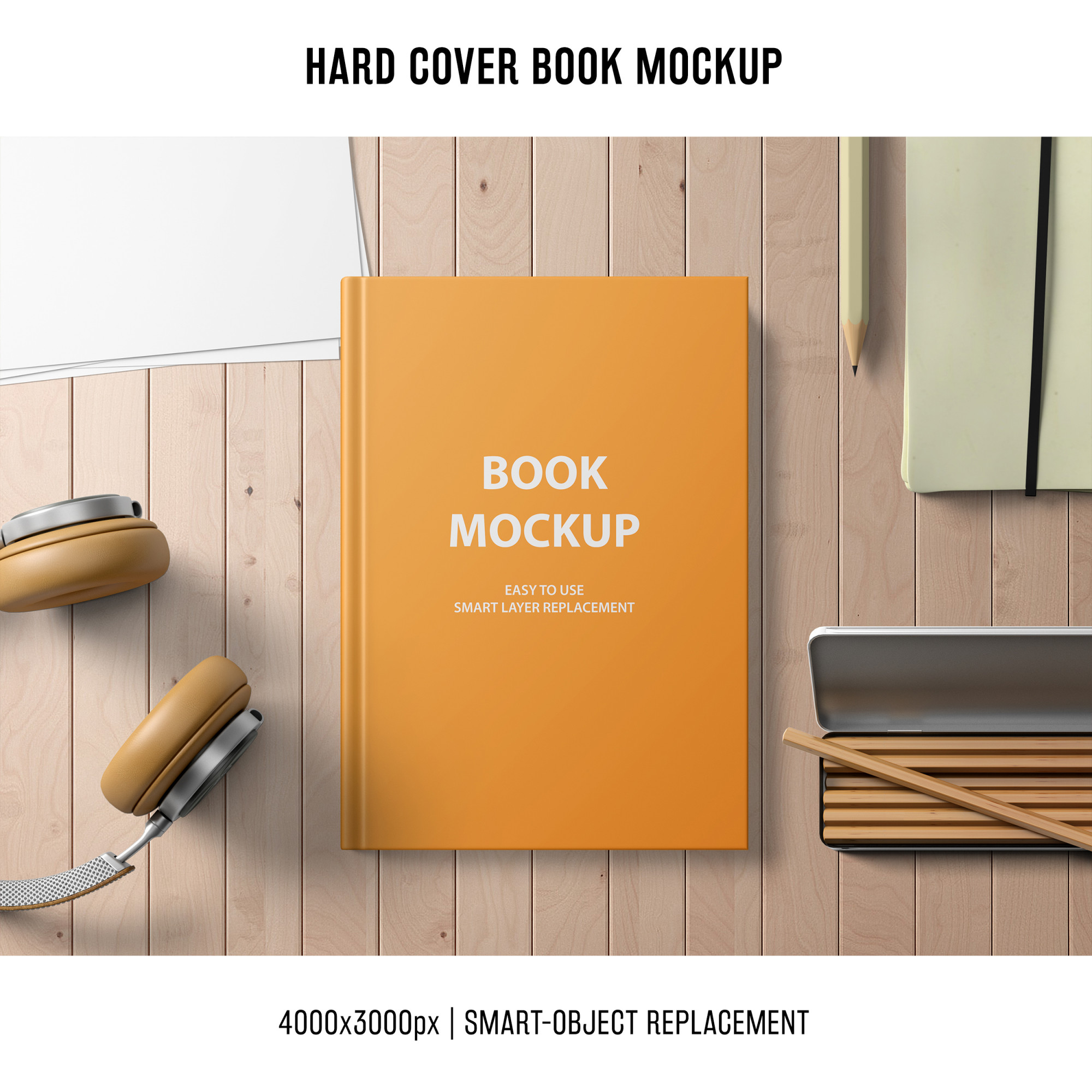Hard cover book mockup with headphones and pencils