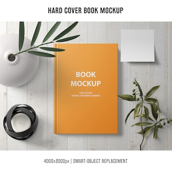 Hard cover book mockup with plants