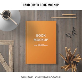 Hard cover book mockup with wooden elements