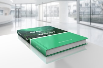 Hardcover book on table mockup