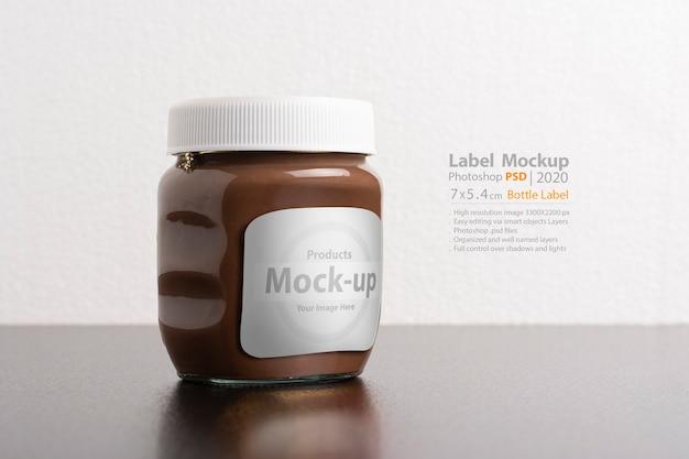 Hazelnut spread chocolate jar with round cap on black table