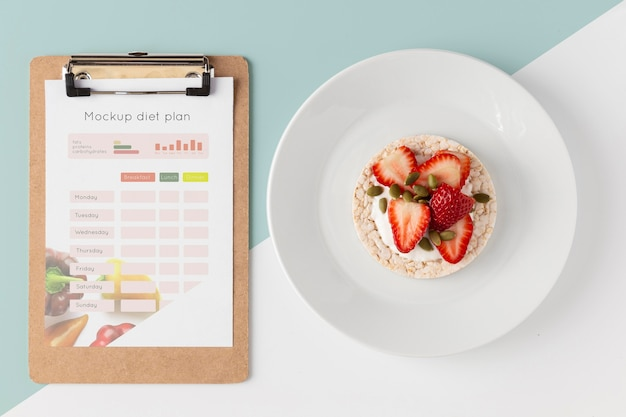 Healthy snack and clipboard