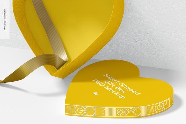 종이 리본 목업이있는 하트 모양의 선물 상자가 열렸습니다.