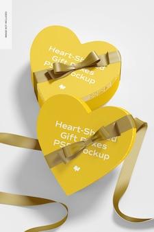 종이 리본 모형이있는 하트 모양의 선물 상자
