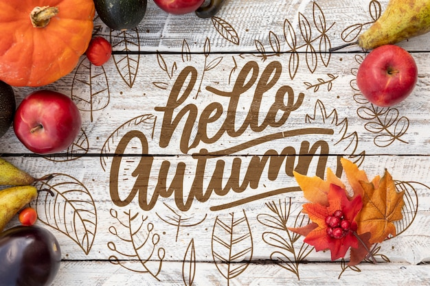 Hello autumn concept with apples and pumpkin