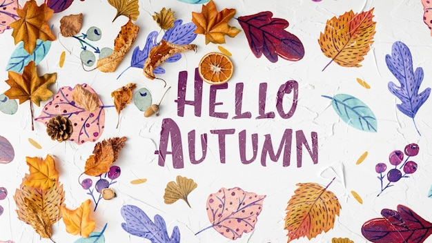 Hello autumn greeting text with dried leaves