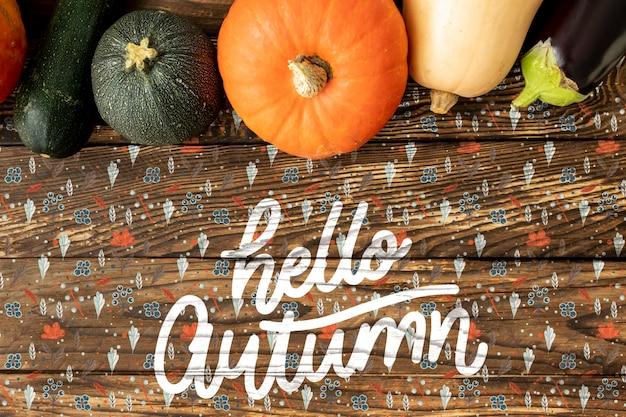 Hello autumn hand lettering phrase with veggies
