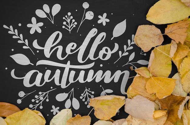 こんにちは、黒の背景に秋のレタリング
