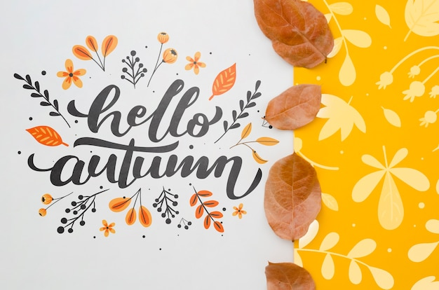 Hello autumn lettering next to yellow leaves pattern
