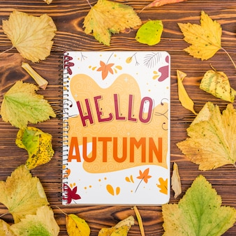 Hello autumn message on notebook with mock-up