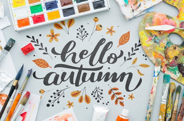 Hello autumn message with acrylic pallette and brushes