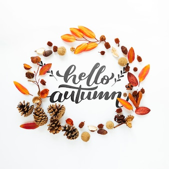 Hello autumn quote in a circle of dried leaves