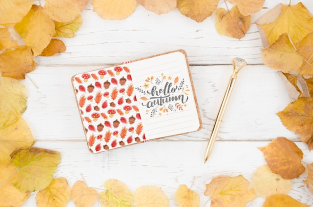 Hello autumn quote written on a notepad