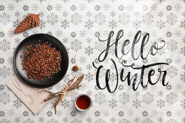 Hello winter message and coffee on table