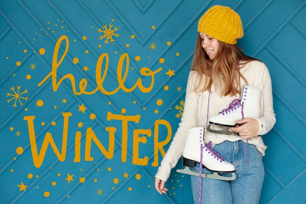 Hello winter text lettering and girl with skates