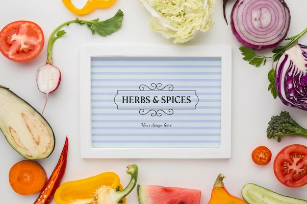 Herbs and spices card surrounded by veggies